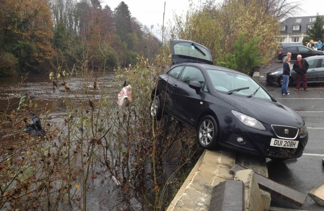 Another car almost swept away from Jackson's car park.