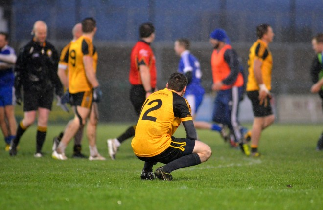 A devastated Jamie Brennan looks on at the final whistle in the Intermediate Ulster final at Owenbeg.