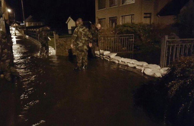 Members of the Army on sand bag duty on Saturday night. Pic courtesy of the Irish Defence Forces