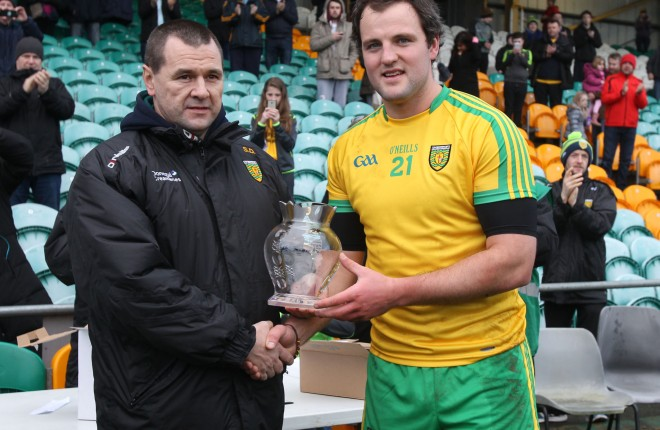 County Chairman Sean Dunnion makes a presentation to Michael Murphy on the occasion of his 100th appearance for Donegal.