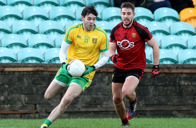 Odhran MacNiallais, Donegal in possession against Ryan Boyle of Down in the McKenna Cup clash Photos: Donna El Assaad