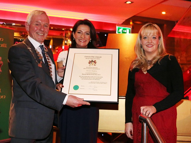 Donegal Association president Hugh Harkin and chairperson Elaine Caffrey presenting Deirdre McGlone, Harvey's Point Hotel, with the framed certificate. Deirdre is the current Donegal Person of the Year by the Donegal Association in Dublin.