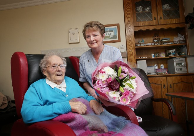 Grace Doherty (90) presenting a bouquet of flowers to home help Sally McLaughlin following her last visit to her home at Ballymaghey, Fanad this week.