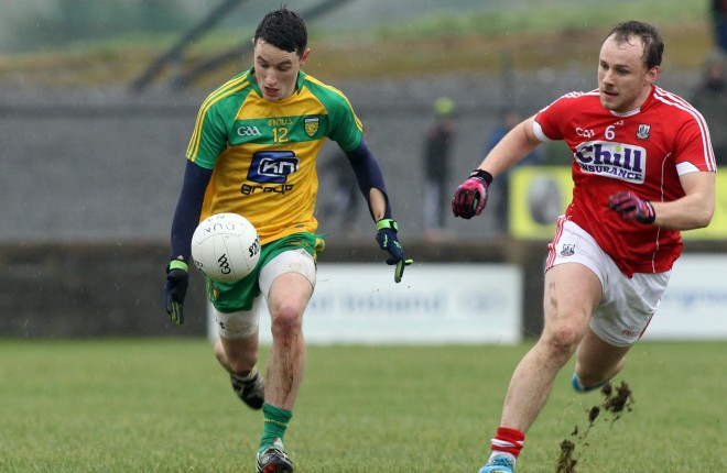 Eoin McHugh, Donegal in action against Brian O'Driscoll, Cork.