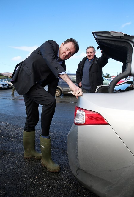 Fianna Fail Charlie McConalogue gets into his wellies for a canvass of Milford Mart. Included is Jim Friel.