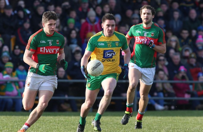 Marty O'Reilly, Donegal in action against Lee Keegan and Tom Parsons.