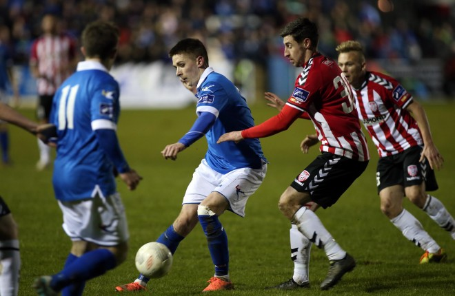 Finn Harps Ryan Curran gets the pass away against Aaron Barry of Derry City last week. Photo: Donna El Assaad
