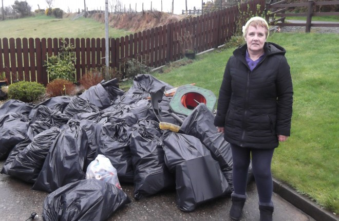 Primrose Rankin with bags of rubbish she collected