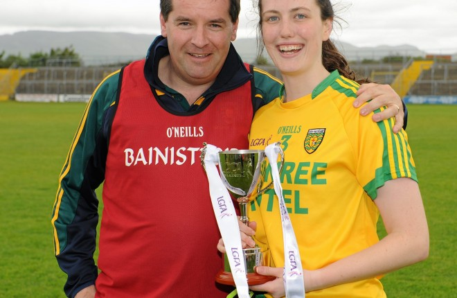 21 June 2015; Donegal Manager Davy McLaughlin and Captain Emer Gallagher pose with the trophy after their team's victory. Aisling McGing U21 B Championship Final, Donegal v Longford, Markiewicz Park, Sligo. Picture credit: Seb Daly / SPORTSFILE
