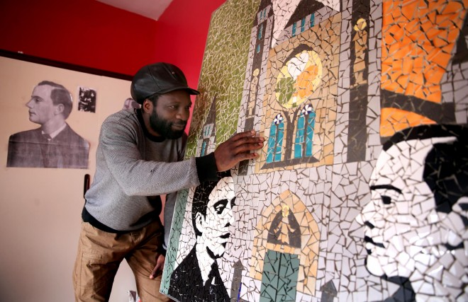Mocola Vonga puts the finishing touches to his 1916 Centenary mosaic.