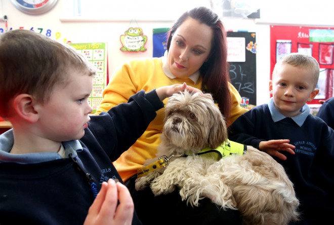 Little Angels School pupils Killian Roulston and Ryan Meehan meeting Sara Kavourmas and 'Loui'.