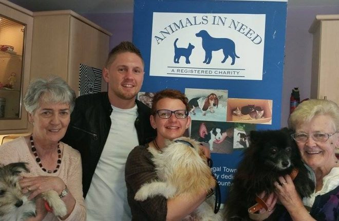 Volunteers from the charity, Animals in Need with boxer, Jason Quigley