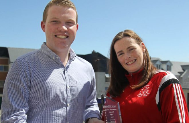 Ryan Ferry, Donegal News presents the April Sports Personality Award to Denise McElhinney, Raphoe Hockey Club.
