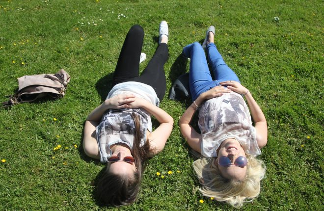 Sunny days in Donegal.... Sisters Kalyn and Aisling Mulligan relax in the sunshine at Letterkenny Town Park on Wednesday afternoon. Photo: Donna El Assaad