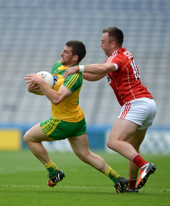Paddy McGrath of Donegal in action against Paul Kerrigan of Cork.