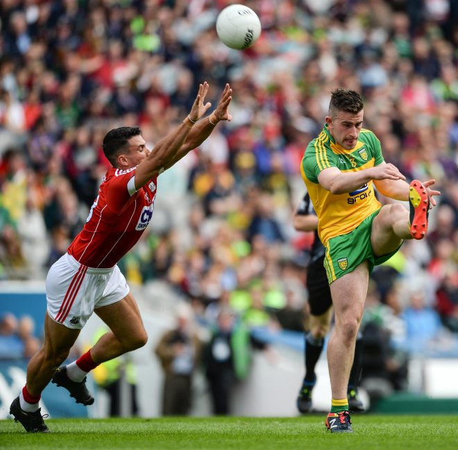Star man for Donegal Patrick McBrearty who scored 11 points in action against Tom Clancy of Cork. Photo: Sportsfile