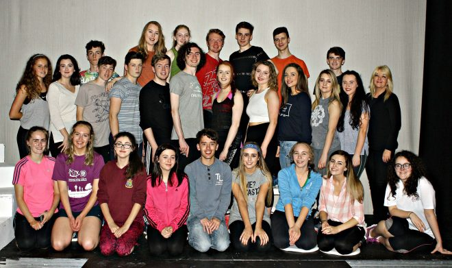 The cast of 'Grease' with director, Caroline Bell.