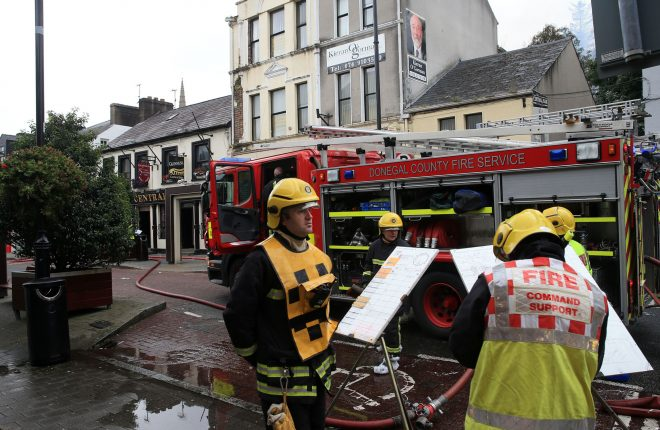 Fire service personnel at the scene of a fire in a storeroom at the Central Bar, Letterkenny this morning.