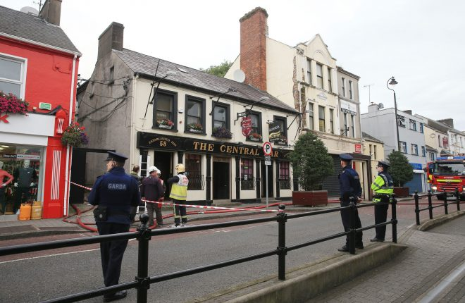 Gardai and Fire service personnel at the scene of a fire at the Central Bar, Letterkenny this morning.