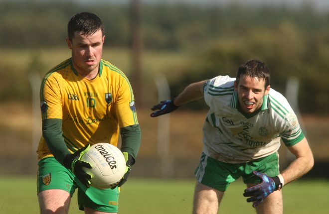 Ryan McNern, Naomh Columba gets past St. Naul's Conor McBrearty during the intermediate championship semi final.