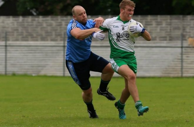 Milford's Paddy Peoples tackles Niall Harley of Aodh Ruadh
