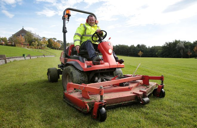 Gardener Joe Moore cutting the grass at Letterkenny Town Park.