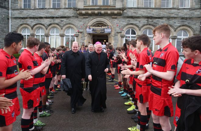 Bishop Philip Boyce makes his way to the opening of the St. Eunan's College pitch yesterday (Thursday).