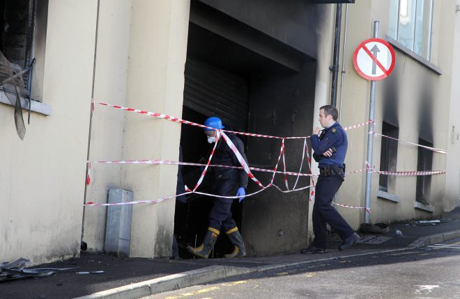 Garda' forensics investigate the fire in a car-park on Rosemount Lane. Photo: Donna El Asssaad