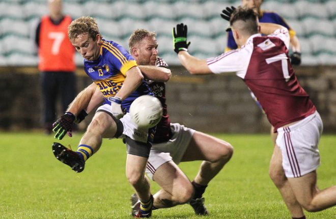 Dara O'Donnell, Kilcar feels the challenge by Jamie Gallagher, Termon last week. Photo: Donna El Assaad