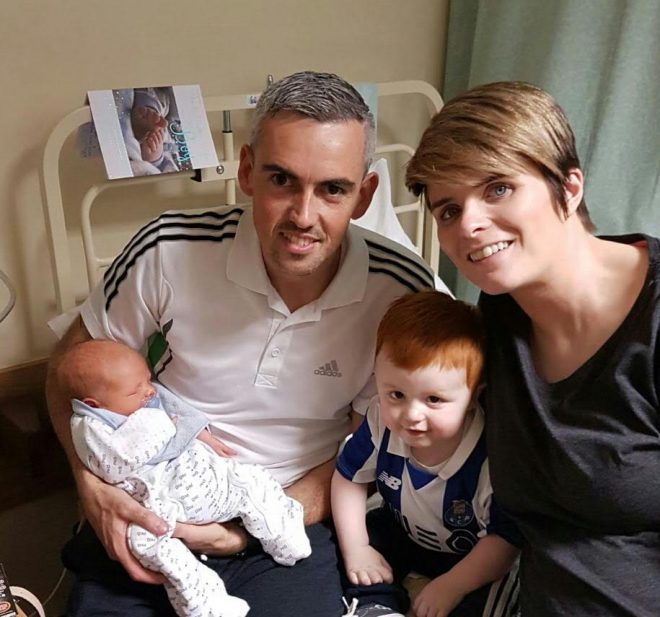 Caolan Melaugh with his parents, Gerard and Stacey and new baby brother Eoghan.
