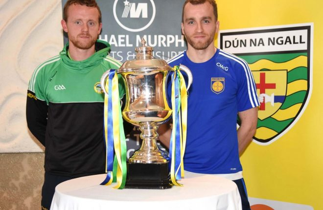 Glenswilly captain Gary McFadden and Kilcar skipper Ciaran McGinley, with the Dr Maguire Cup