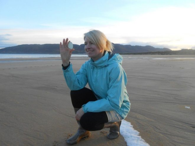 Helen collecting another fine piece of seaglass from the beach at Portsalon.