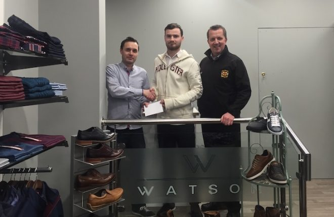 Peter is pictured receiving his award from Paul Moore (left) of Watson Menswear and USL Secretary Niall Callaghan