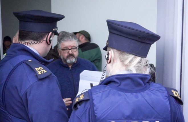 Michael McGee, 'The Helping Hand' spokesman in conversation with Gardai on Friday afternoon