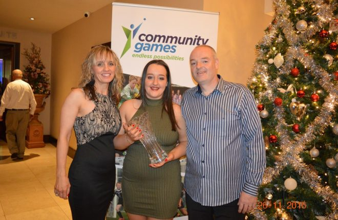 Alysha Heron with the Youth Volunteer Award and her parents, Margaret and Charlie