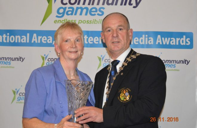 Mary O'Donnell Milford being presented with her National Adult Volunteer award by President Gerry Davenport at the Community Games Awards function in Galway.
