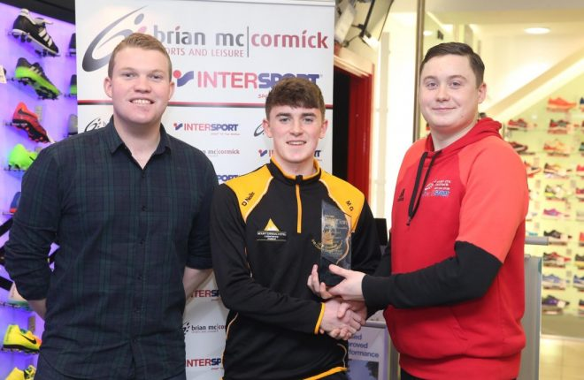 Dan O'Donnell, Brian McCormick Sports, presents Michael Gallagher with the Donegal News Sports Star of the Month award for December. Also pictured is Ryan Ferry (left) of the Donegal News.