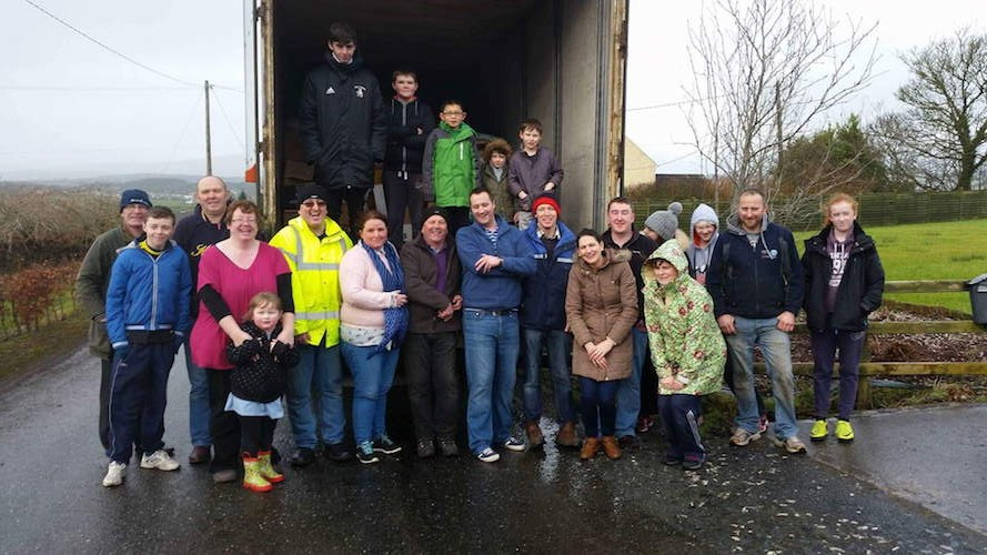 Myrtle Doherty and the team behind the collection for Belarus pictured as last year's lorry load prepared to leave Ramelton.