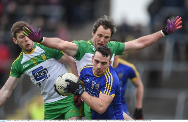 Roscommon's Thomas Featherstone under pressure from Michael Murphy and Eoghan 'Ban' Gallagher.
