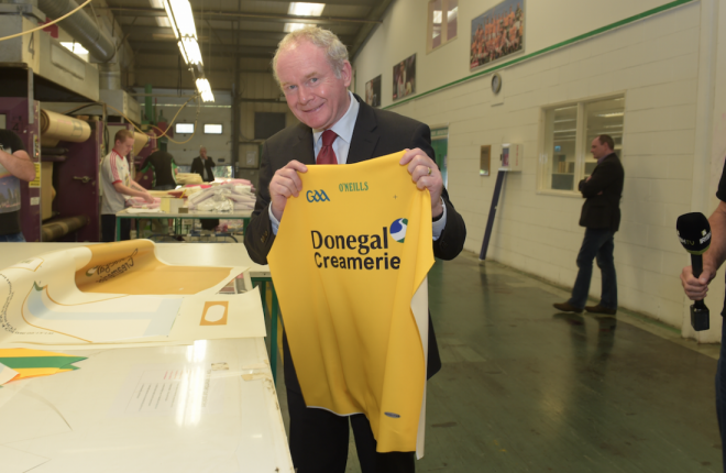 Martin McGuinness with the Donegal jersey he was presented with during a visit to O'Neill's factory in Strabane back in 2014.