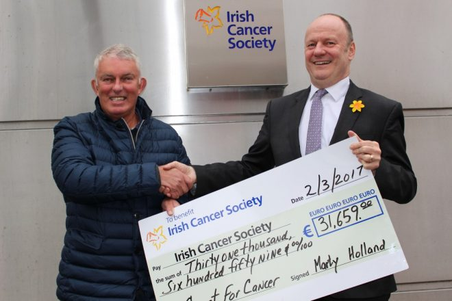 Dr Marty Holland presents the proceeds from the first leg of his Coast for Cancer challenge to Mark Mellett, Head of Fundraising, Irish Cancer Society.
