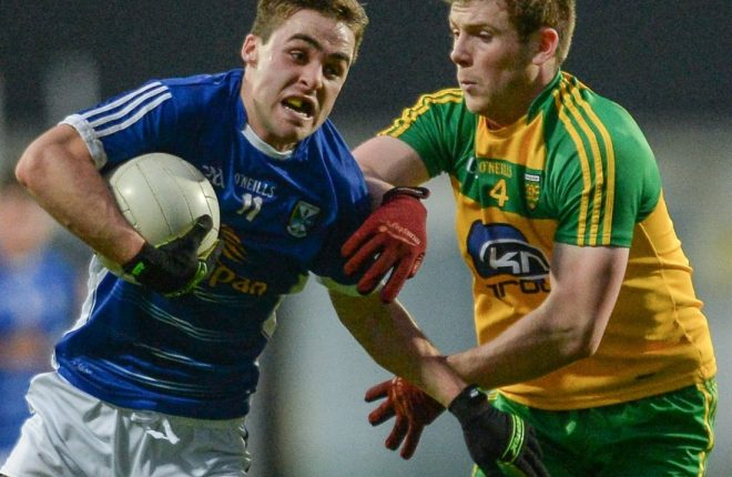 Eoghan 'Ban' Gallagher tackles Cavan's Conor Bradley