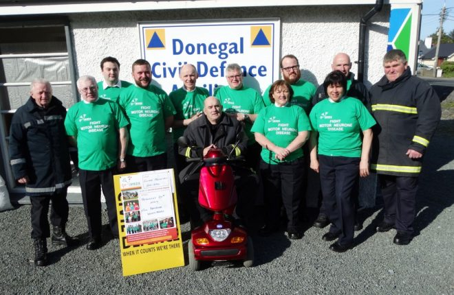 Members of the Civil Defence with Auxiliary Fire Service member John Cunningham. On May 20 the gang will tackle Errigal in aid of the Motor Neurone Association.