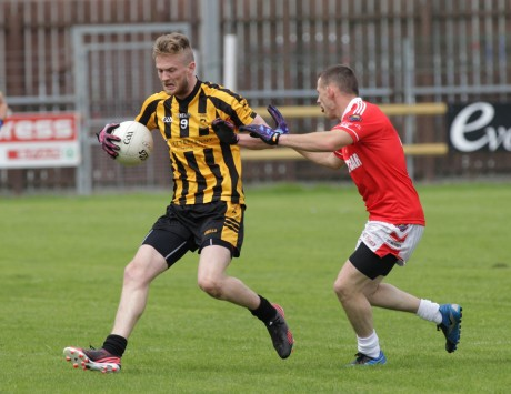 St Eunan's Ross Wherity in action against Stephen Horan of St Michaels yesterday in O'Donnell Park. Photo: Donna McBride.