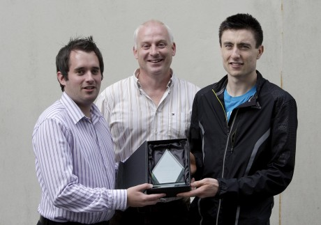 Mark English receives the Donegal News Sports Personality of the Month award for July 2013 from Chris McNulty and Harry Walsh.
