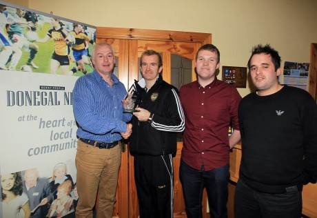 Gary McDaid, Glenswilly GAA Manager receives the November Sports Star Award from the Donegal News' Harry Walsh, Ryan Ferry and Chris McNulty.