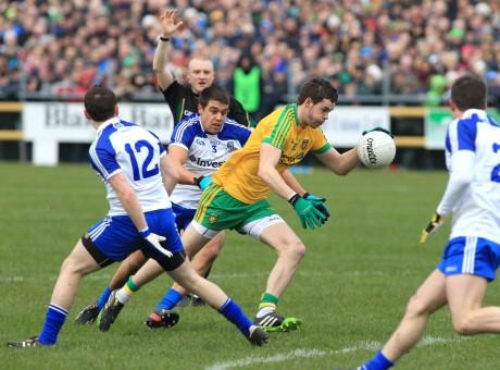 Donegal's Odhrán Mac Niallais breaks through the Monaghan defence to score a goal.