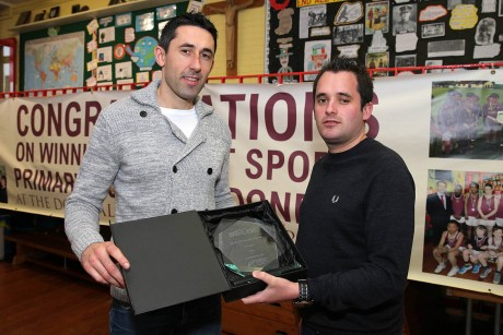Chris McNulty presents the Donegal News Sport Personality of the Month award for October to Rory Kavanagh.