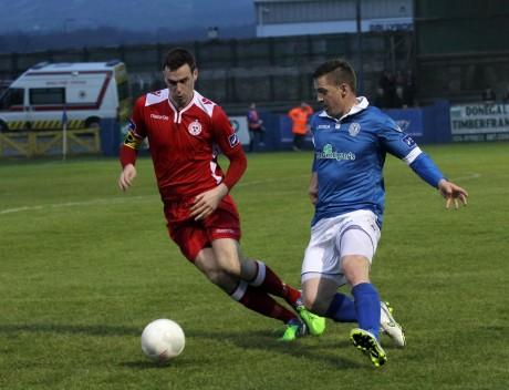 Kevin McHugh, Finn Harps in action against Paul Andrews, Shelbourne at Finn Park. Photo: Donna El Assaad
