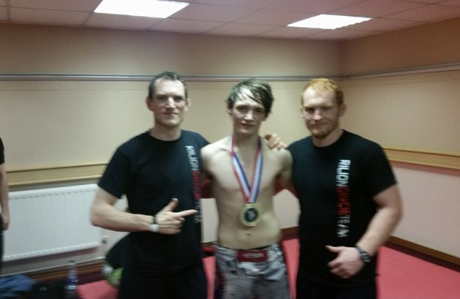 Damien McLaughlin with his Rilion Gracie coaches Brian Coyle and Steve Coll